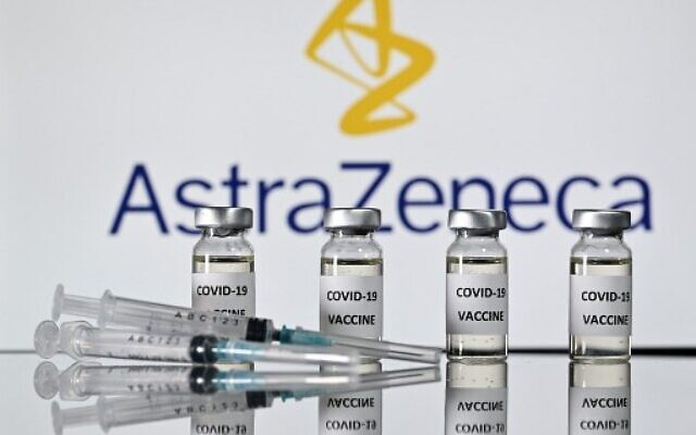 An illustration picture shows vials with COVID-19 Vaccine stickers attached and syringes with the logo of British pharmaceutical company AstraZeneca on November 17, 2020. (JUSTIN TALLIS/AFP)