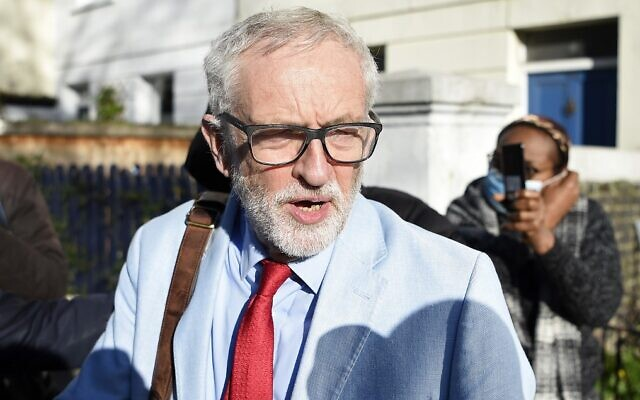Jeremy Corbyn, former leader of Britain's Labour Party, leaves his home in north London on November 18, 2020. (Daniel Leal-Olivas/AFP)