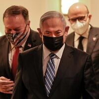(L to R) US Secretary of State Mike Pompeo, Israeli Prime Minister Benjamin Netanyahu, and Bahrain's Foreign Minister Abdullatif bin Rashid Al Zayani, all mask-clad due to the COVID-19 coronavirus pandemic, arrive for a press conference after their trilateral meeting in Jerusalem on November 18, 2020. (Menahem KAHANA / POOL / AFP)