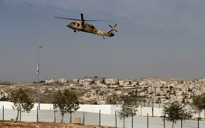 An Israeli airforce Blackhawk helicopter carrying US Secretary of State Mike Pompeo hovers over Sha'ar Binyamin industrial park near the Psagot settlement in the West Bank, north of Jerusalem, on November 19, 2020. (Ahmad GHARABLI/AFP)