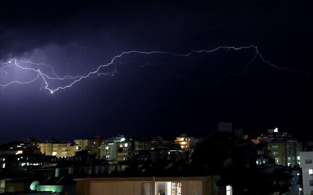 Lightning strikes above the Israeli coastal city of Netanya, north of Tel Aviv, on November 20, 2020. (Photo by JACK GUEZ / AFP)