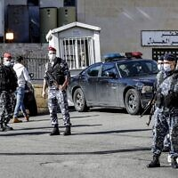 Policemen stand guard outside a detention center from which prisoners had fled earlier in Baabda, east of Lebanon's capital Beirut, on November 21, 2020. (Anwar Amro/AFP)