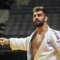 Israel's Peter Paltchik reacts after defeating Bulgarian Boris Georgiev during the men's under-100 kilogram weight category quarter final at the European Judo Championship 2020 in Prague, on November 21, 2020. (Michal Cizek/AFP)