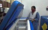 A pharmacy officer conducts routine checks of the Electronic Vaccine Intelligence Network (EVIN) cold storage equipment, at a government hospital proposed by the Bangalore municipality for the storage and dispatch of the COVID-19 vaccine when available, in Bangalore on November 23, 2020. (Manjunath Kiran/AFP)