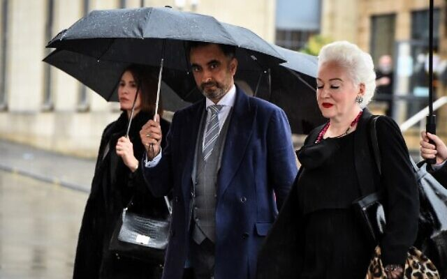 British lawyer Aamer Anwar (C) arrives with members of his team to take part on the opening day of a posthumous appeal against the conviction of Libyan Abdelbaset Mohmet al-Megrahi for the 1988 bombing of Pan Am Flight 103 over the town of Lockerbie. (Andy Buchanan / AFP)