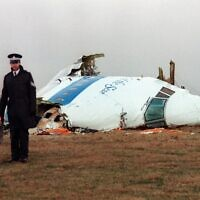 Policemen stand near the wreckage of the 747 Pan Am airliner that exploded and crashed over Lockerbie, Scotland, December 22, 1988. (Roy Letkey/AFP)