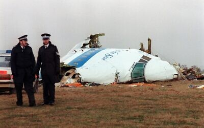Hours after the event, policemen stand near the wreckage of the 747 Pan Am airliner that exploded and crashed over Lockerbie, Scotland, on December 21, 1988. (Roy Letkey/AFP)