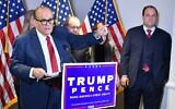 Trump lawyer Rudy Giuliani speaks at a press conference watched by Trump campaign adviser Boris Epshteyn, right, at the Republican National Committee headquarters in Washington, DC, November 19, 2020. (Mandel Ngan/AFP)