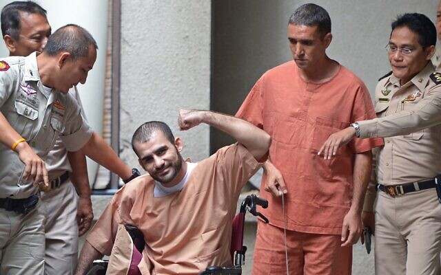 Saeid Moradi (C), an Iranian suspected of involvement in the February 2012 bomb blasts in Bangkok, and fellow suspect Mohammad Khazaei (2nd-R) appear at a court in Bangkok, August 22, 2013. (Pornchai Kittiwongsakul/AFP)