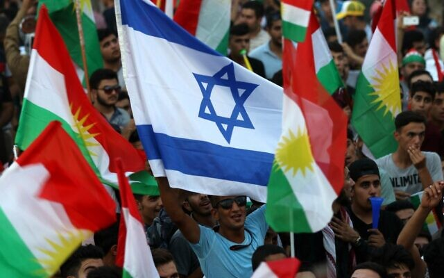 Iraqi Kurds wave an Israeli flag and Kurdish flags during an event urging people to vote in an independence referendum in Arbil, the capital of the autonomous Kurdish region of northern Iraq, September 16, 2017. (Safin Hamed/AFP)