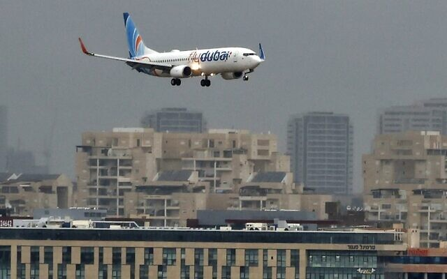 An airplane of budget airline Flydubai lands at Israel's Ben Gurion airport near Tel Aviv on November 26, 2020, on the first scheduled commercial service between the two cities, following the normalization of ties between the UAE and Israel. (JACK GUEZ / AFP)