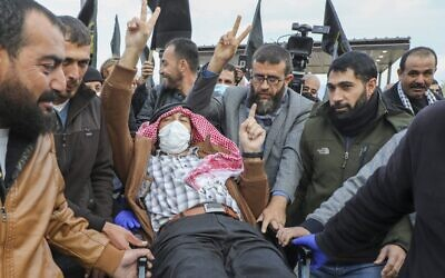 Palestinian detainee Maher al-Akhras arrives at his home in the West Bank village of Seylat al-Dhahr, south of Jenin city, following his release by Israeli authorities on November 26, 2020. (JAAFAR ASHTIYEH / AFP)