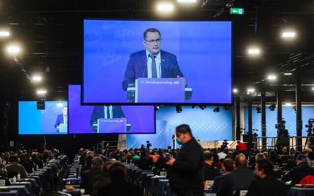 Tino Chrupalla, Federal Spokesperson, is seen on video screens during his speech at the Party Congress of farright AfD party at the Wunderland Kalkar, western Germany, on November 28, 2020. (INA FASSBENDER / AFP)