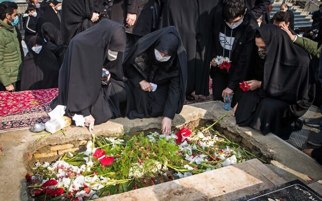 Iranian mourners attend the burial ceremony of slain nuclear scientist Mohsen Fakhrizadeh at Imamzadeh Saleh shrine in northern Tehran, on November 30, 2020. (HAMED MALEKPOUR / TASNIM NEWS / AFP)