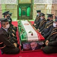Members of Iranian forces pray around the coffin of slain nuclear scientist Mohsen Fakhrizadeh during the burial ceremony at Imamzadeh Saleh shrine in northern Tehran, on November 30, 2020. (HAMED MALEKPOUR / TASNIM NEWS / AFP)