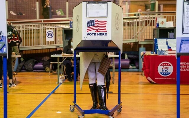A voter casts a ballot at a polling station in New York City on November 1, 2020. (David Dee Delgado/Getty Images/AFP)