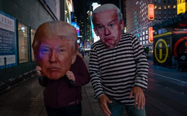 People in Times Square dressed in Donald Trump and Joe Biden costumes as they await election results on November 3, 2020 in New York City. (David Dee Delgado/Getty Images/AFP)