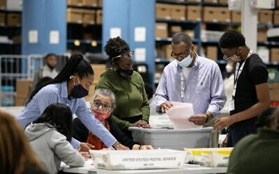 Gwinnett County election workers look over absentee and provisional ballots at the Gwinnett Voter Registrations and Elections office on November 6, 2020, in Lawrenceville, Georgia. (Jessica McGowan/Getty Images/AFP)