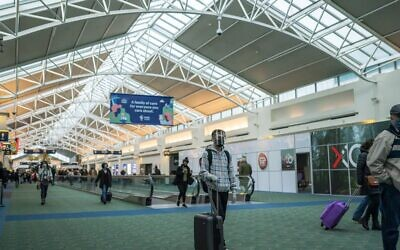 Travelers walk through Portland International Airport on November 25, 2020 in Portland, Oregon. (Nathan Howard/Getty Images/AFP)