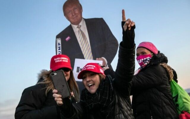 Supporters of President Donald Trump wait to enter the Gerald R. Ford International Airport for the President's final campaign rally on November 02, 2020 in Grand Rapids, Michigan.  ( John Moore/Getty Images/AFP)