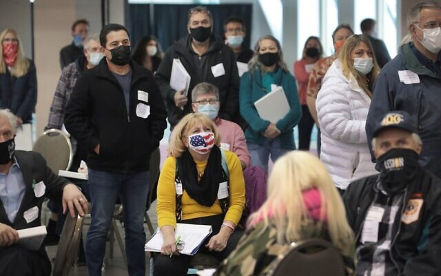 Observers listen as procedural issues are argued during the process of recounting ballots from the November 3 election at the Wisconsin Center on November 20, 2020 in Milwaukee, Wisconsin. (Scott Olson/Getty Images/AFP)
