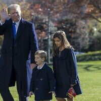 US President Donald Trump, followed by his grandchildren, Arabella Kushner and Theodore Kushner, walks on the south lawn of the White House on November 29, 2020, in Washington, DC. (Tasos Katopodis/Getty Images/AFP)