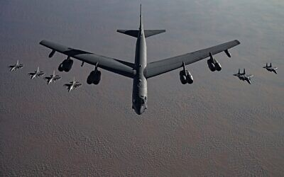 A B-52 heavy bomber, flanked by fighter jets, flies to the Middle East in a tacit threat to Iran on November 21, 2020. (US Air Force/Facebook)