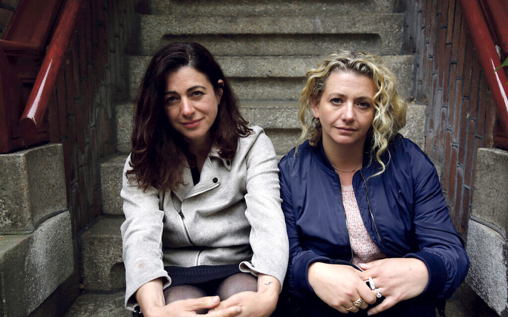 Sisters Natalie and Louisa Clein on the steps of the house in Amsterdam, the Netherlands, where their grandmother lived when she was in the Resistance during World War II. They visited for the BBC One program 'My Family, The Holocaust and Me,'  by Robert Rinder. (Wall to Wall Media/ Mike Robinson)