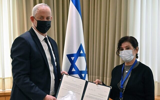 Defense Minister Benny Gantz (L) with Yael Grill, a member of a government committee of inquiry into the Case 3000 submarine affair, November 22, 2020. (IDF)
