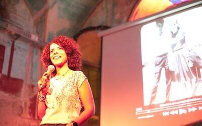 Director Ibtisam Mara'ana-Menuhin discusses her work at a film screening in Jerusalem (courtesy)