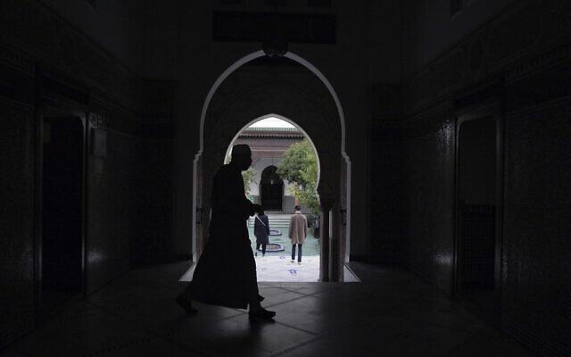 A man walks inside a mosque in Paris, France, October 29, 2020. (AP/Thibault Camus, FILE)