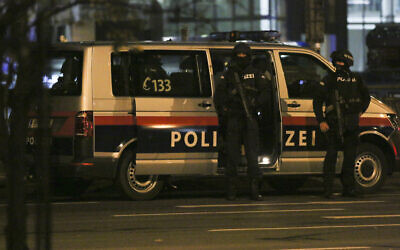 Police officers in position following a shooting attack, in Vienna, Austria, November 3, 2020. (Ronald Zak/AP)