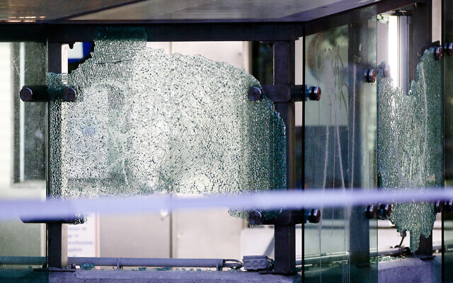After a shooting incident the glass at an entrance of a car parking is broken  in Vienna, Austria, November 3, 2020. (Ronald Zak/AP)