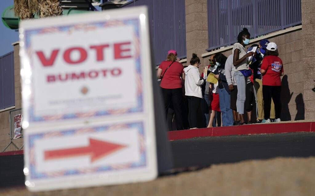 People wait in line to vote at a polling place on Election Day, November 3, 2020, in Las Vegas. (AP Photo/John Locher)