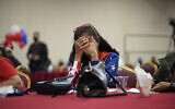 US President Donald Trump supporter Loretta Oakes reacts while watching returns in favor of Democratic presidential candidate former Vice President Joe Biden, at a Republican election-night watch party, November 3, 2020, in Las Vegas. (AP Photo/John Locher)