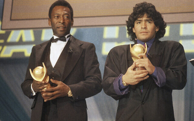 """In this March 1987 file photo, Pele, left, and Maradona hold """"Sports Oscar"""" trophies in Milan, Rome. (AP)"""