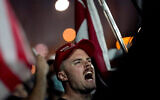 Supporters of US President Donald Trump rally outside the Maricopa County Recorders Office on November 4, 2020, in Phoenix. (AP Photo/Matt York)