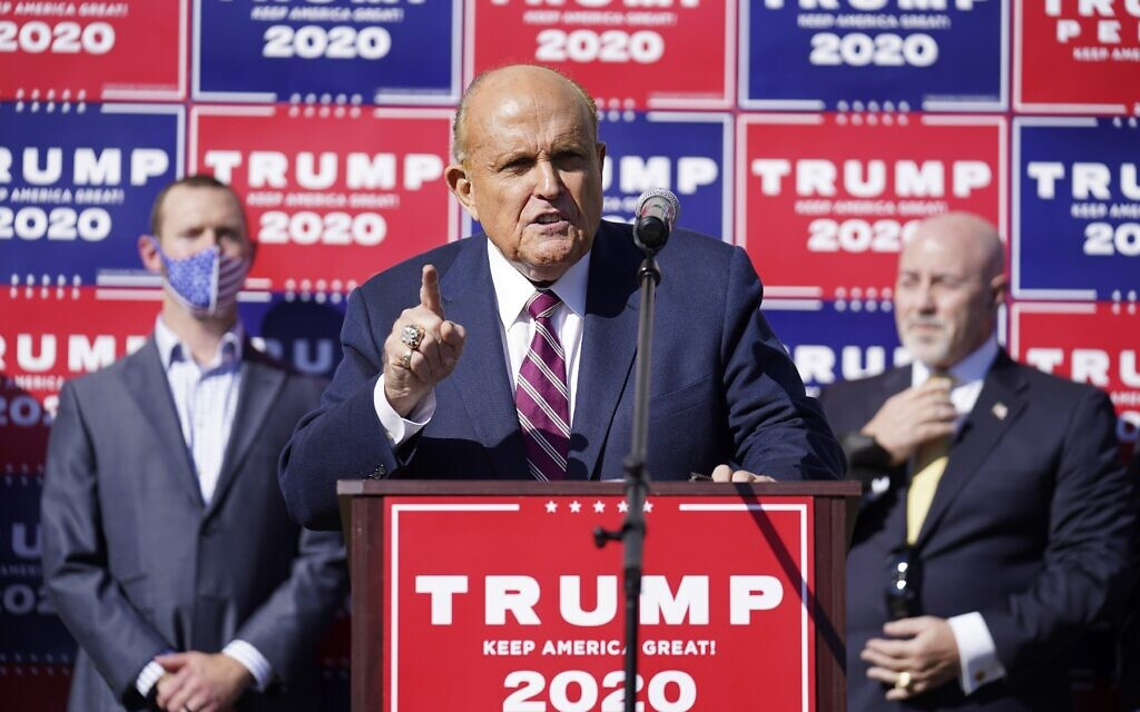 Former New York mayor Rudy Giuliani, a lawyer for US President Donald Trump, speaks during a news conference on legal challenges to vote counting in Pennsylvania, Saturday Nov. 7, 2020, in Philadelphia. (AP Photo/John Minchillo)