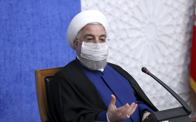Iran's President Hassan Rouhani speaks in a meeting in Tehran, Iran, November 8, 2020. (Iranian Presidency Office via AP)