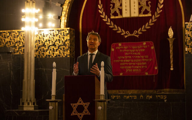 Rene de Reuver, speaking on behalf of the General Synod of the Protestant Church in the Netherlands, reads a statement at the Rav Aron Schuster Synagogue in Amsterdam, Netherlands, November 8, 2020. (AP Photo/Peter Dejong)