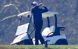 US President Donald Trump plays a round of golf, at the Trump National Golf Club in Sterling Virginia, November 8, 2020. (Steve Helber/AP)