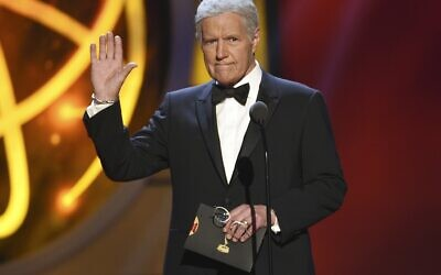 "This May 5, 2019, file photo shows Alex Trebek gestures while presenting an award at the 46th annual Daytime Emmy Awards in Pasadena, Calif. Jeopardy!"" host Alex Trebek died Sunday, Nov. 8, 2020, after battling pancreatic cancer for nearly two years. Trebek died at home with family and friends surrounding him, ""Jeopardy!"" studio Sony said in a statement. Trebek presided over the beloved quiz show for more than 30 years. (Photo by Chris Pizzello/Invision/AP)"