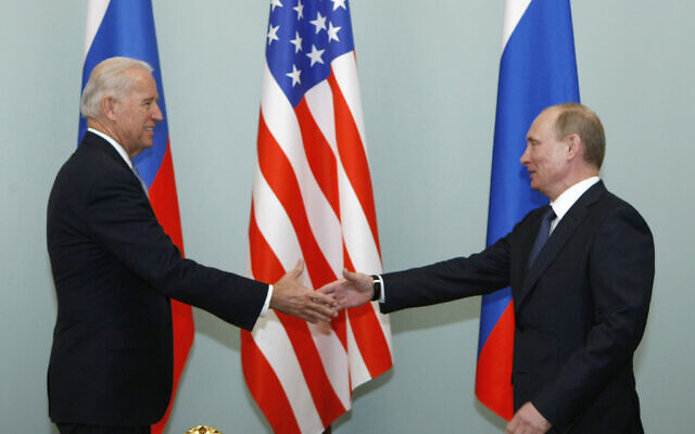 In this March 10, 2011, file photo, US Vice President Joe Biden, left, shakes hands with Russian Prime Minister Vladimir Putin in Moscow, Russia. (AP/Alexander Zemlianichenko, File)