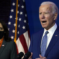 US President-elect Joe Biden, joined by Vice President-elect Kamala Harris, speaks at The Queen theater, November 9, 2020, in Wilmington, Delaware. (AP Photo/Carolyn Kaster)