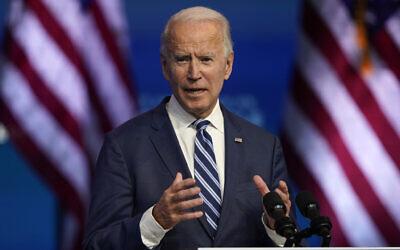 US President-elect Joe Biden speaks at The Queen theater in Wilmington, Delaware, November 10, 2020, (AP Photo/Carolyn Kaster)