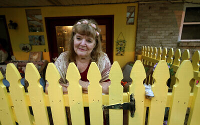 Joan Martin poses for a portrait on the front porch of her home in Picayune, Missippi, November 11, 2020. (AP Photo/Gerald Herbert)