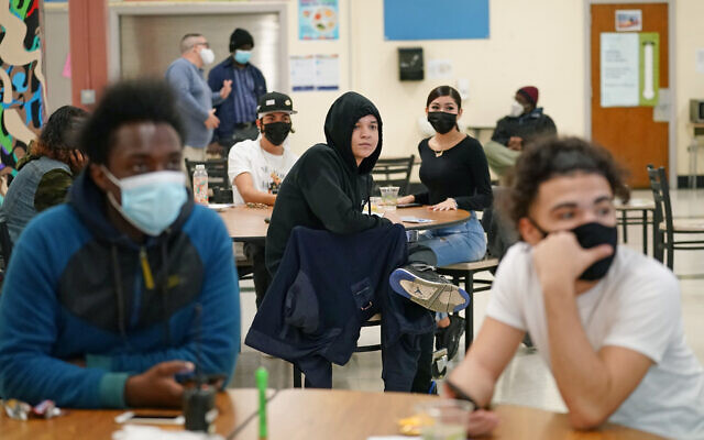 Students at West Brooklyn Community High School listen to questions posed by their principal during a current events-trivia quiz and pizza party in the school's cafeteria, in New York on October 29, 2020. (AP/Kathy Willen, File)