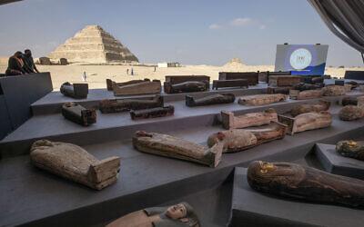 People look at ancient sarcophagi on display, discovered in a vast necropolis in Saqqara, Giza, Egypt, November 14, 2020. (AP Photo/Nariman El-Mofty)