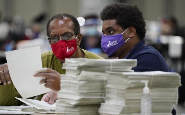 Officials sort ballots during an audit at the Georgia World Congress Center in Atlanta, on November 14, 2020. (Brynn Anderson/AP)