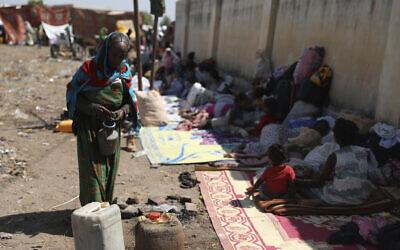 Refugees from the Tigray region of Ethiopia arrive at Hamdayet, Sudan on Saturday, November 14, 2020. (AP Photo/Marwan Ali)